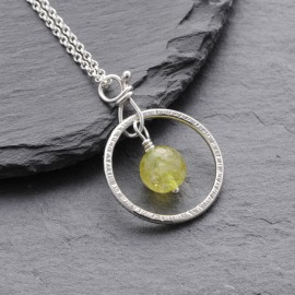 Sterling Silver Ring with Peridot Pendant
